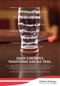 Advert for Chiltern Railway's traditional rail ale trail showing a nearly empty pint glass on pub table, with the marks of the beer representing stops on the route.