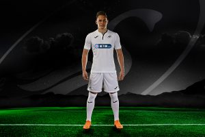 Connor Roberts. professional football player, Swansea City AFC, defender wearing the home stip standing on football field with mountains and starry sky in the background and Swansea City logo floating in the sky