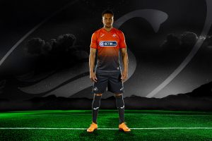 Martin Olsson. professional football player, Swansea City AFC, defender wearing the home stip standing on football field with mountains and starry sky in the background and Swansea City logo floating in the sky